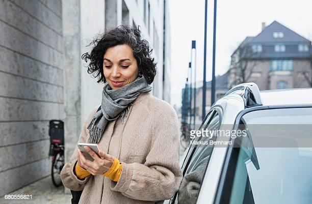 Woman texting with cellphone