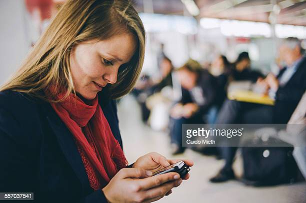 Woman texting with smartphone.