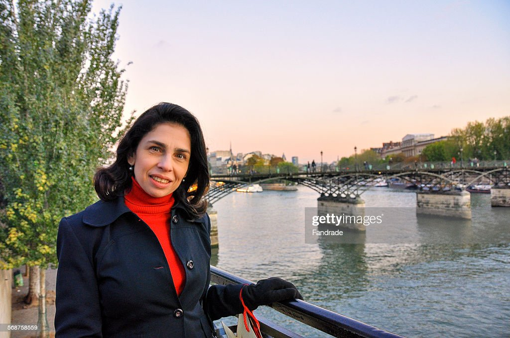 Woman the banks of the Seine in Paris : Stock Photo