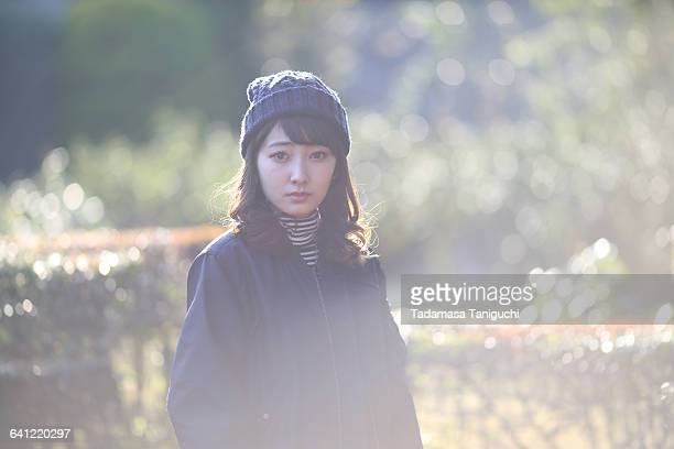 woman thinking about her future - coat ストックフォトと画像