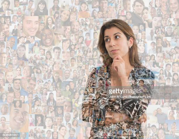 Woman thinking over montage of smiling faces