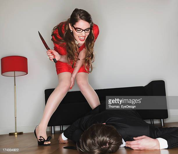 woman thrill over her defeat of man with knife - bending over stock pictures, royalty-free photos & images