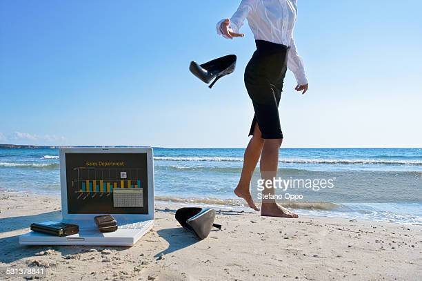 Woman throw her shoes and stop working