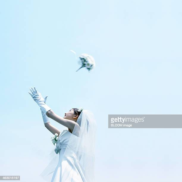 Woman Throwing A Bouquet