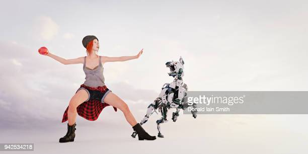 Woman throwing ball for robot dog to fetch