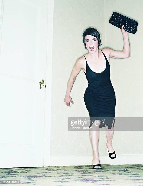 Woman Throwing Computer Keyboard