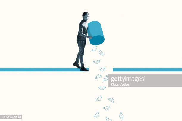 woman throwing disposable masks from garbage bin - finishing stock pictures, royalty-free photos & images