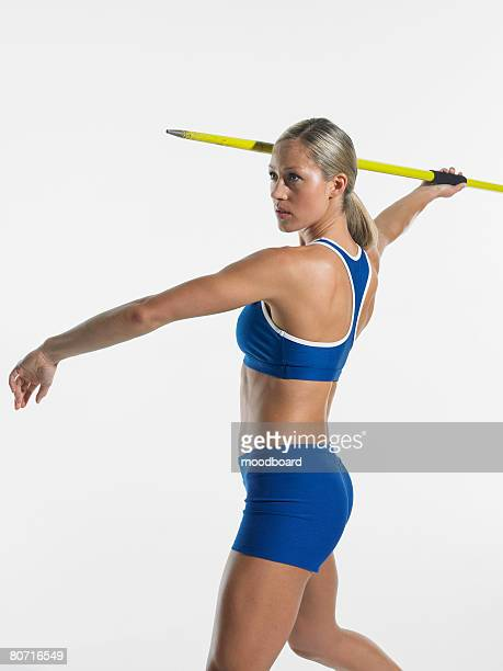 woman throwing javelin - women's field event stock pictures, royalty-free photos & images