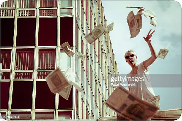 woman throwing out money - throwing stock pictures, royalty-free photos & images