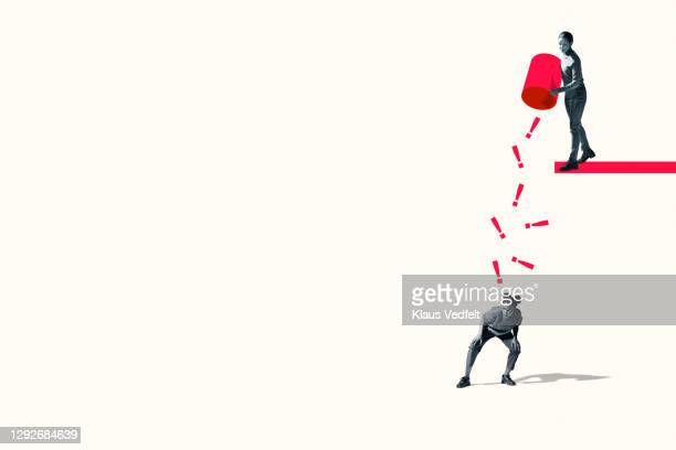 woman throwing red exclamation points on friend - oresund region stock pictures, royalty-free photos & images
