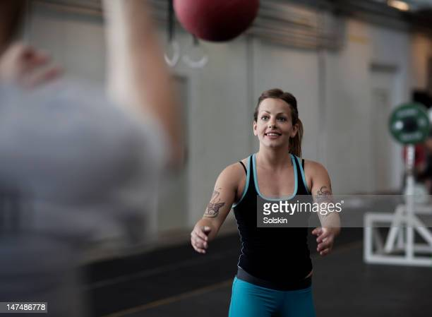 woman throwing training ball in gym