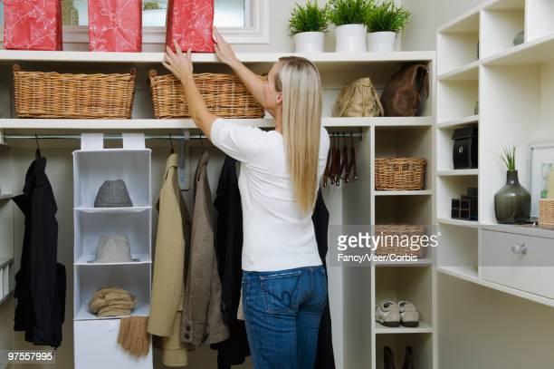 Woman Tidying Walk-in Closet
