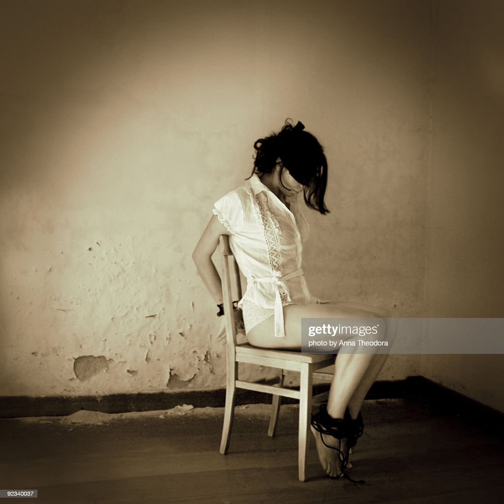 woman tied to chair stock photo | getty images