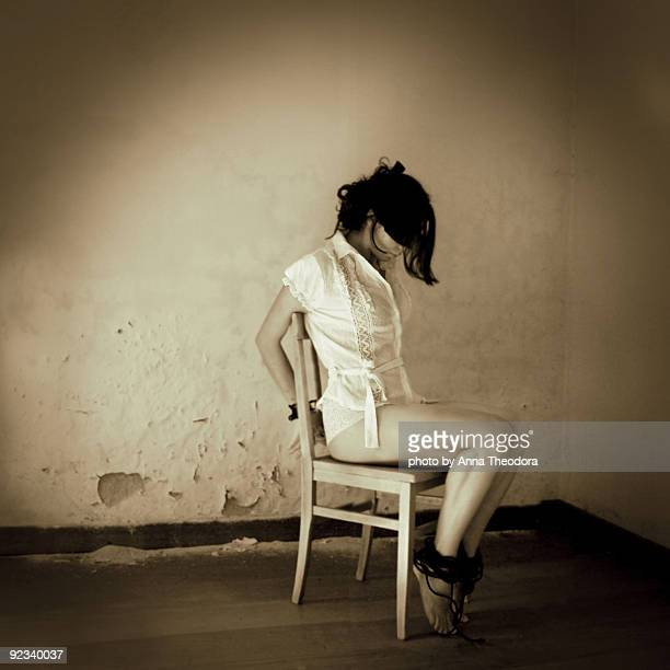 woman tied to chair - bound woman stock photos and pictures