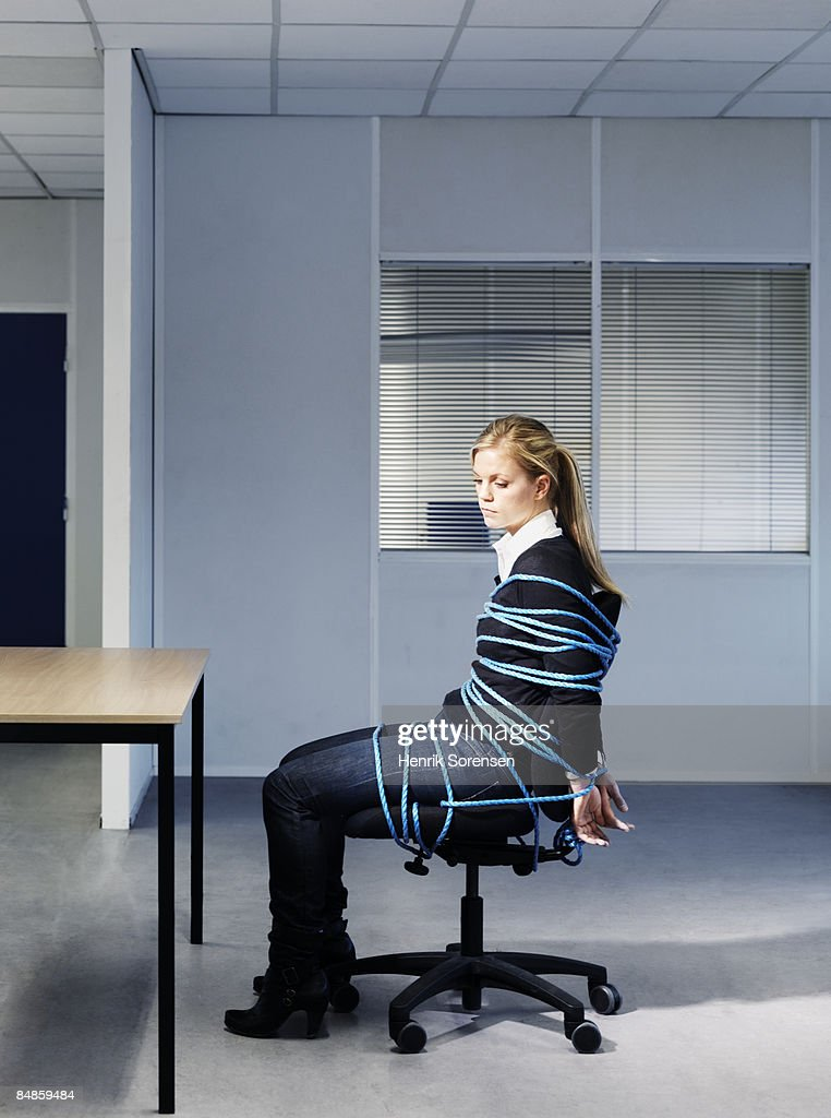Woman tied to her office chair. : Stock Photo
