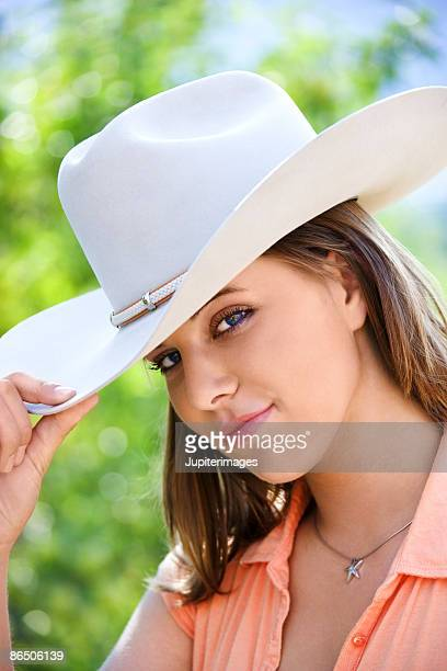 Woman tipping cowboy hat