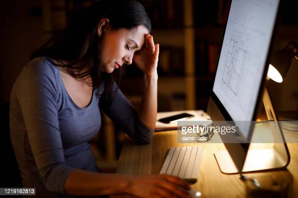 woman tired of working - avoidance stock pictures, royalty-free photos & images