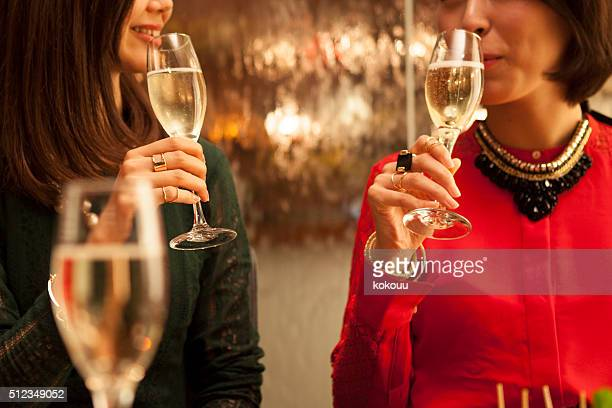 woman to taste the champagne - millionnaire stock pictures, royalty-free photos & images