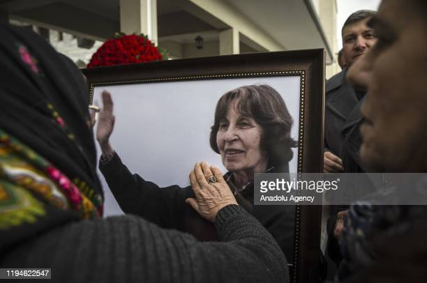 Woman touches a photo of Rahsan Ecevit, wife of late Turkish Prime Minister Bulent Ecevit, during her funeral ceremony at the Kocatepe Mosque in...
