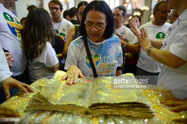A woman touches a relic during a mass officiated by Cardinal Stanislaw Rylko to celebrate the arrival in Brazil of the relics of blessed John Paul II...