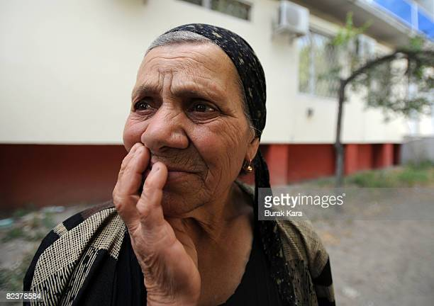 A woman touches her face on August 16 2008 near the village of Igoeti on the road from Gori to Tbilisi about 45 kilometres from Tbilisi Georgia US...
