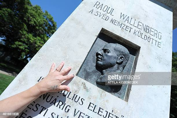 WOHLERT FILES A woman touches the memorial stone of late Swedish diplomat Raoul Wallenberg in St Istvan park of Budapest on August 1 2012 prior to...