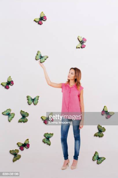 Woman touching a butterfly