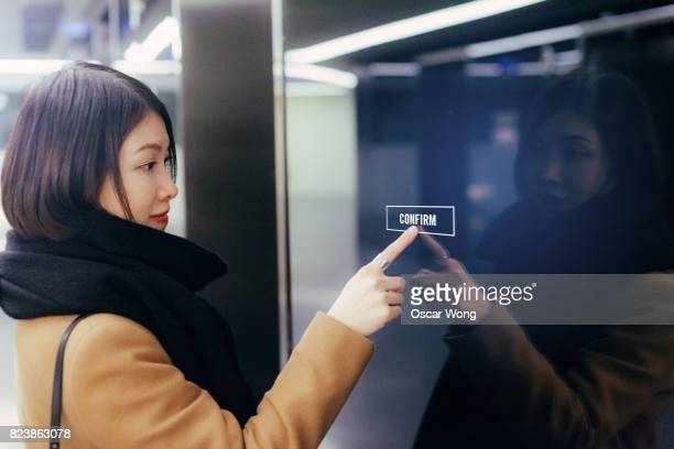 woman touching a large interactive digital panel - touch sensitive stock pictures, royalty-free photos & images