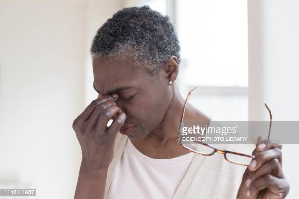 woman touching bridge of nose - eye injury stock pictures, royalty-free photos & images