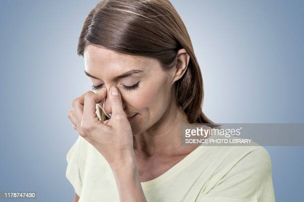 woman touching bridge of nose - sinus stock pictures, royalty-free photos & images