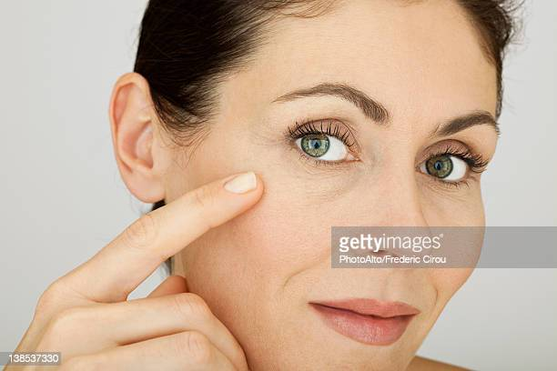 Woman touching face, portrait