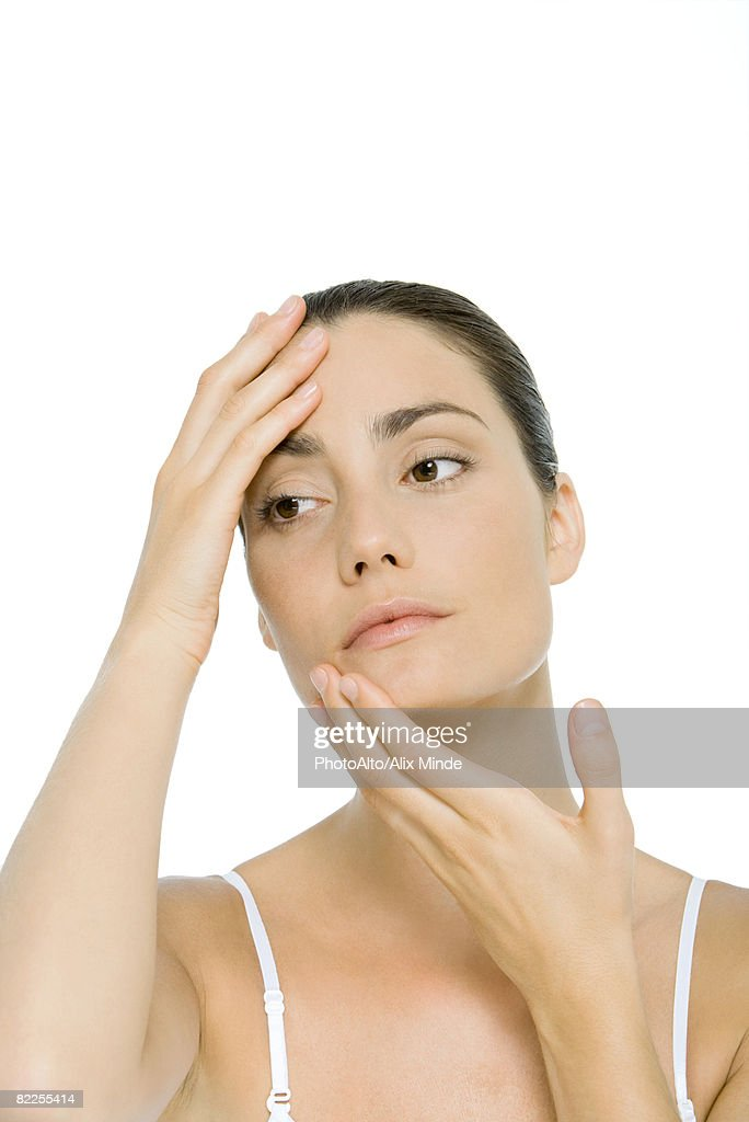 Woman touching face, portrait : Stock Photo