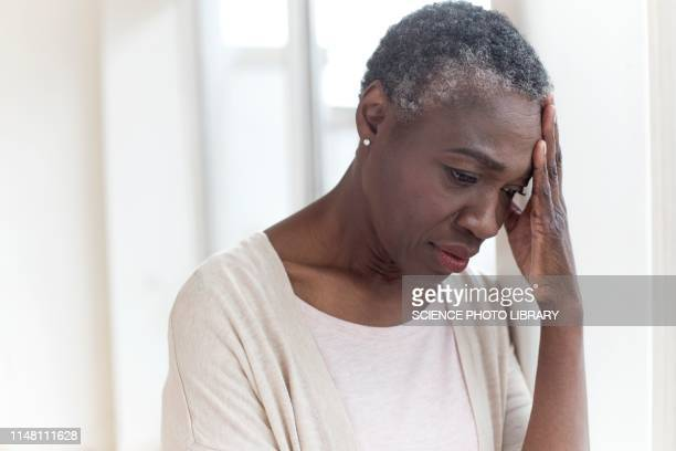 woman touching head - alzheimer's disease stock pictures, royalty-free photos & images
