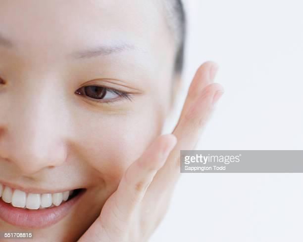 Woman Touching Her Cheek