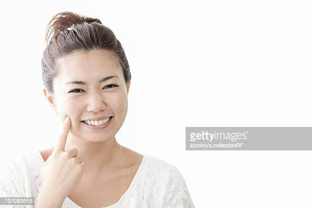 Woman touching her cheek with finger, Tokyo Prefecture, Honshu, Japan