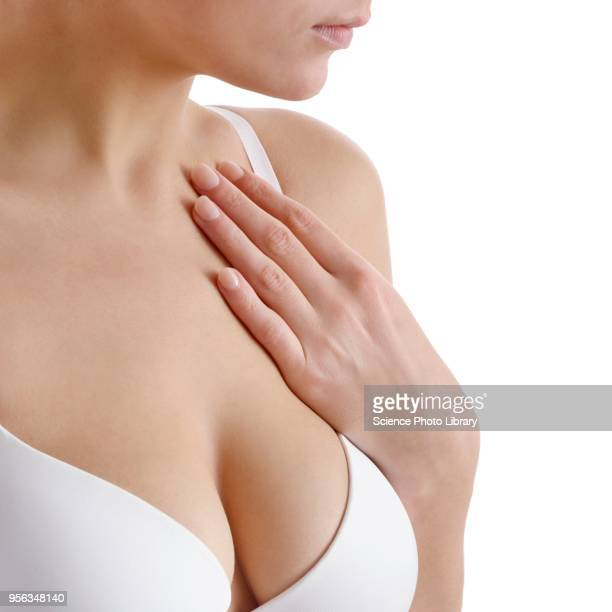 woman touching her chest - busen nahaufnahme stock-fotos und bilder
