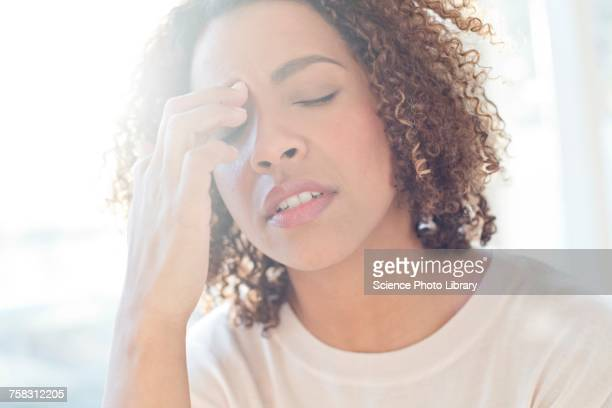 woman touching her face - allergies stock photos and pictures