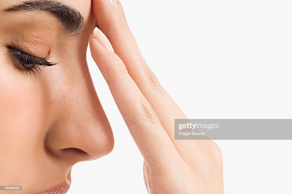 Woman touching her face : Stock Photo