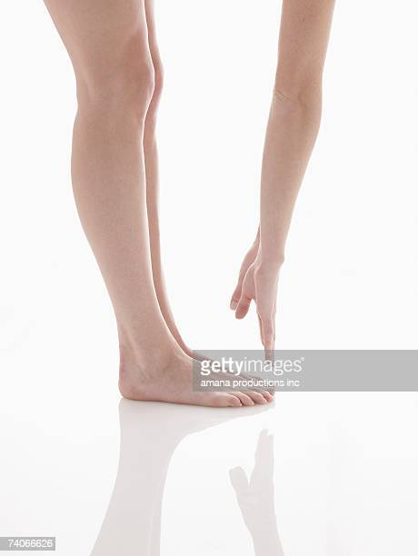 Woman touching her toes (low section)