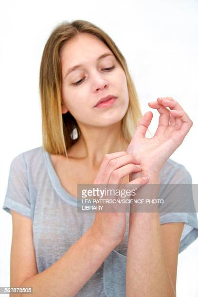 Woman touching her wrist