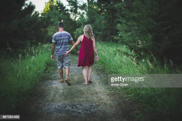 woman touching man's behind - male bum stock photos and pictures