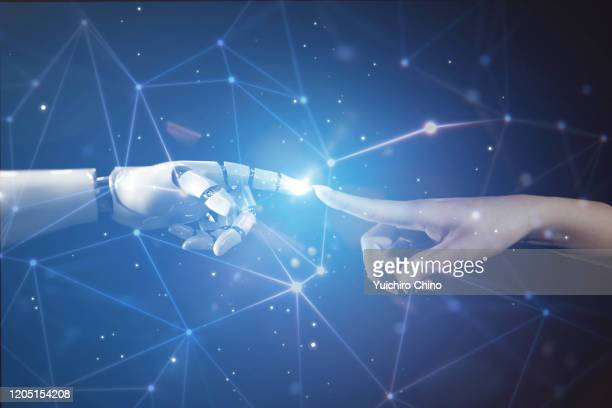 woman touching robot finger - 人工知能 ストックフォトと画像
