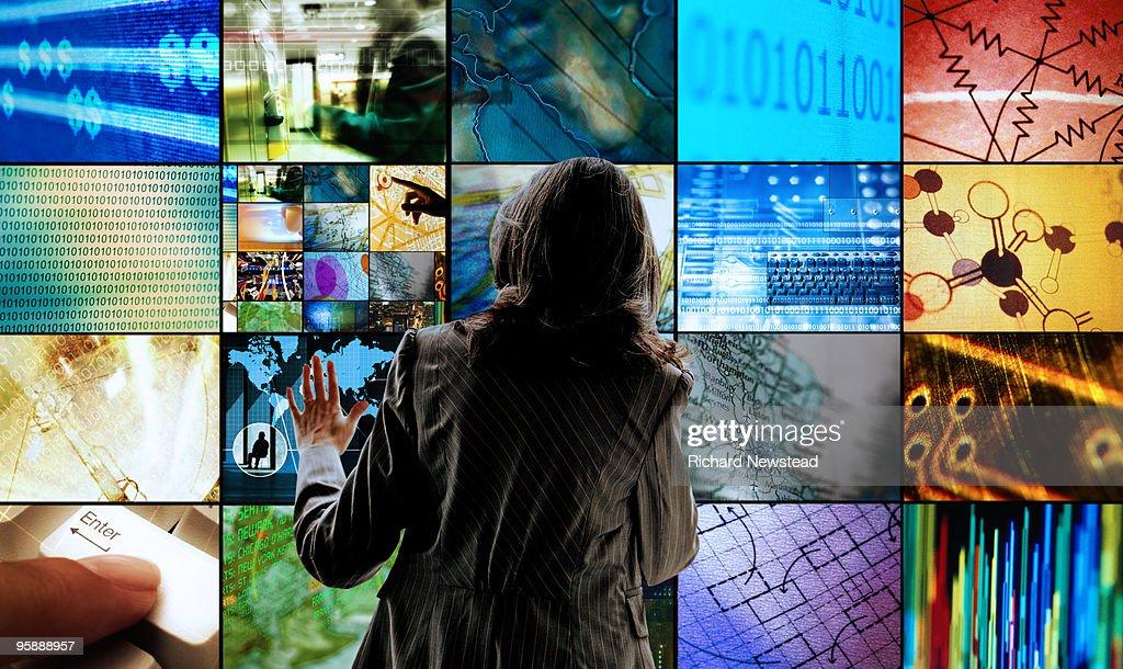 Woman Touching Screens : Stock Photo