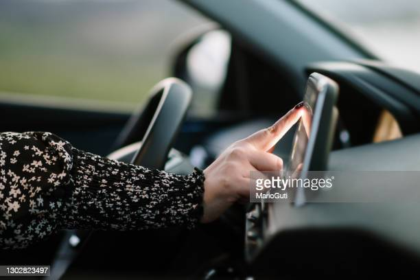 woman touching the touch screen of a car - navigational equipment stock pictures, royalty-free photos & images