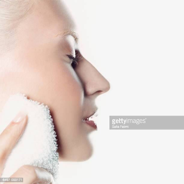 Woman Touching Towel to Face