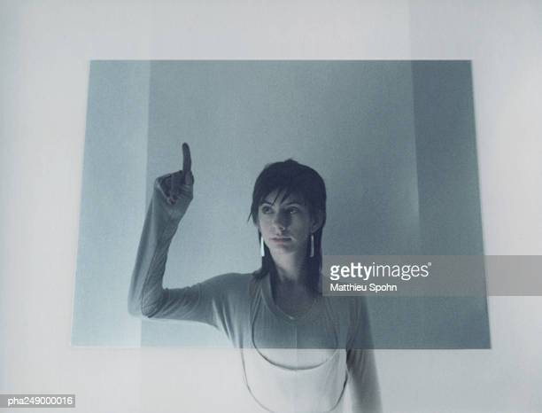 Woman touching translucent screen