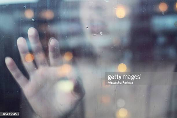 woman touching window from inside - alexandra pavlova stock pictures, royalty-free photos & images