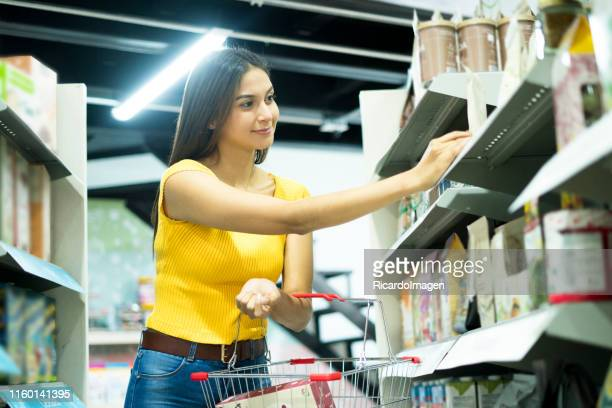 woman touring the supermarket - the americas stock pictures, royalty-free photos & images