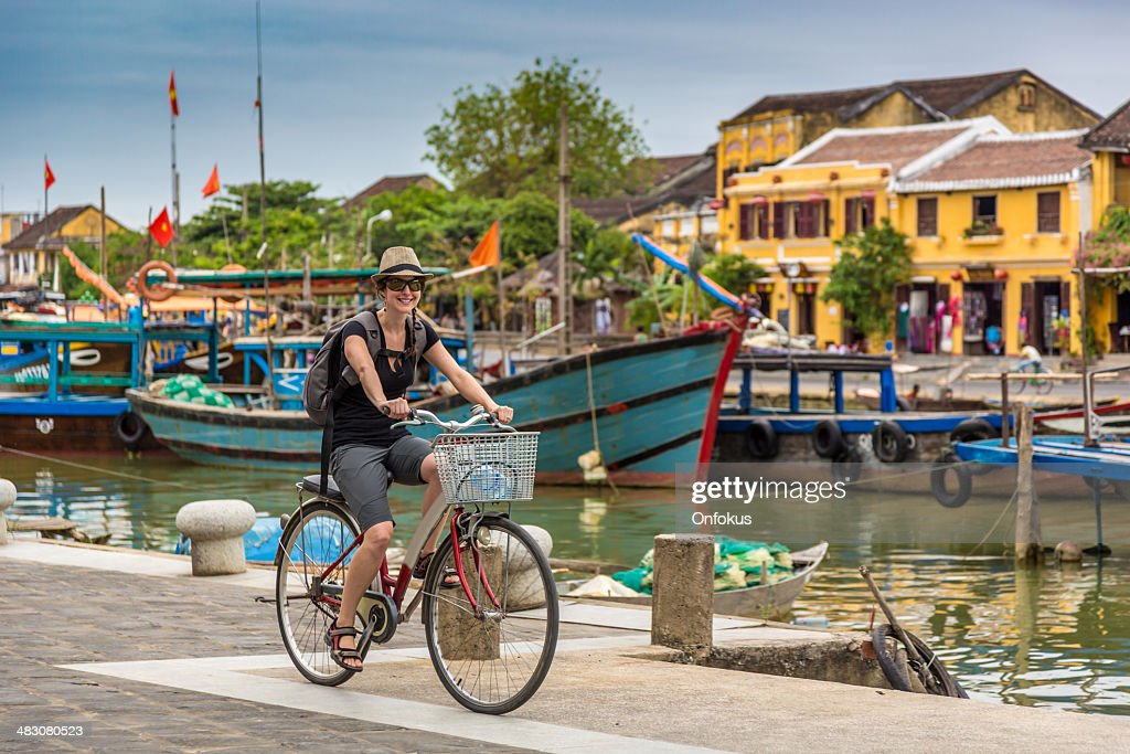 Woman Tourist Cycling in Hoi An City, Vietnam : Stock Photo