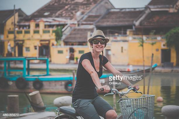 Woman Tourist Cycling in Hoi An City, Vietnam